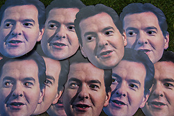 © licensed to London News Pictures. London, UK 05/12/2012. George Osborne masks laid at Unison photocall ahead of Autumn Statement, calling on the Chancellor to act now to avoid a triple dip recession outside the Houses of the Parliament. Photo credit: Tolga Akmen/LNP