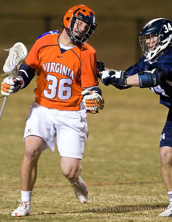 Virginia Cavaliers M Brian Carroll (36) is defended by Mt. Saint Mary's M Shaun Moran (34).  The #2 ranked Virginia Cavaliers defeated the Mt. Saint Mary's Mount 10-2 at the University of Virginia's Klockner Stadium in Charlottesville, VA on February 24, 2009.   (Special to the Daily Progress / Jason O. Watson)