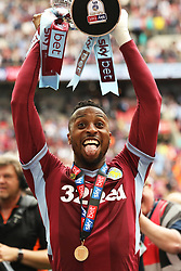 May 27, 2019 - London, England, United Kingdom - Jonathan Kodjia (26) of Aston Villa holds the play off trophy following his sides win during the Sky Bet Championship Play Off Final between Aston Villa and Derby County at Wembley Stadium, London on Monday 27th May 2019. (Credit Image: © Mi News/NurPhoto via ZUMA Press)