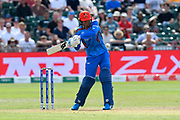 Mujeeb Ur Rahman of Afghanistan plays an attacking shot during the ICC Cricket World Cup 2019 match between Afghanistan and Australia at the Bristol County Ground, Bristol, United Kingdom on 1 June 2019.