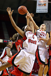 31 December 2007: Whitney Lowe (in back) battles Brea Banks and Brooke Singleton for a loose ball. The Huskies of Northern Illinois University were leashed up by the Redbirds of Illinois State University 78-54 on Doug Collins Court in Redbird Arena in Normal Illinois.