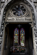Stained glass and arches in the Gothic mausoleum for the Albertin Deron family in the Pere Lachaise cemetery, Paris.