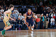 SOUTH BEND, IN - JANUARY 10: Malcolm Brogdon #15 of the Virginia Cavaliers brings the ball up court against the Notre Dame Fighting Irish during the game at Purcell Pavilion on January 10, 2015 in South Bend, Indiana. Virginia defeated Notre Dame 62-56. (Photo by Joe Robbins)