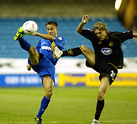 Fotball<br /> England 2004/2005<br /> Foto: SBI/Digitalsport<br /> NORWAY ONLY<br /> <br /> Millwall v Wigan<br /> The League Championship. 10/08/2004<br /> <br /> Dennis Wise cannot lift Millwall as Jimmy Bullard battles for the ball