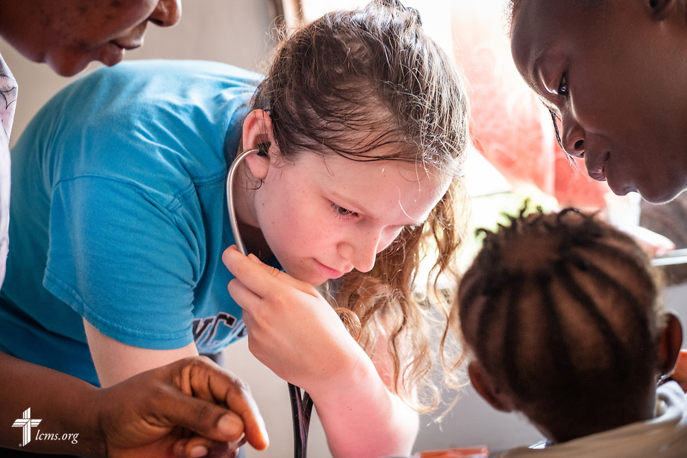 Hayden Rensner, a student at Concordia University, Nebraska, takes vitals on the third day of the LCMS Mercy Medical Team on Wednesday, May 9, 2018, in the Yardu village outside Koidu, Sierra Leone, West Africa. LCMS Communications/Erik M. Lunsford