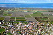 Nederland, Friesland, Gemeente Ferweradeel, 28-02-2016; Ferwerd (Fries: Ferwert) met de Sint Martinuskerk. Terpdorp en beschermd dorpsgezicht. In de achtergrond Waddenzee en het Friesche Wad met landaanwinning.<br /> Village on dwelling mound and protected village, northern Friesland.<br /> <br /> luchtfoto (toeslag op standard tarieven);<br /> aerial photo (additional fee required);<br /> copyright foto/photo Siebe Swart