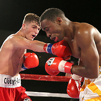 Conor Coyle catches Joshua Maxwell with a clean right hand during a Fire Fist Boxing Promotions boxing match at the A La Carte Pavilion on Saturday, August 12 , 2017 in Tampa, Florida.  (Alex Menendez via AP)