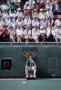 SEOUL, SOUTH KOREA - OCTOBER 1:  Spectators and a tennis official watch the final of the Men's Doubles event of the Tennis competition of the 1988 Summer Olympic Games on October 1, 1988  at the Seoul Olympic Park Tennis Center in Seoul, South Korea.  (Photo by David Madison/Getty Images)