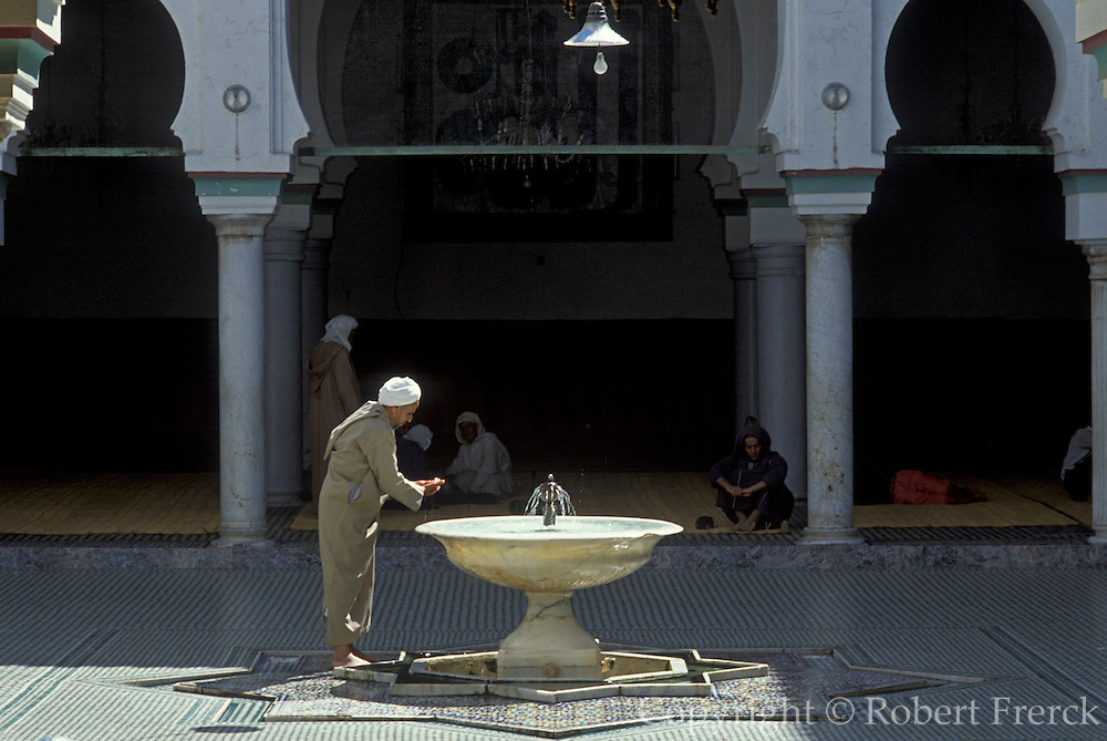 MOROCCO, FEZ Mosque/Tomb of Moulay Idriss II, the 9th century founder of Fez, activity in central courtyard