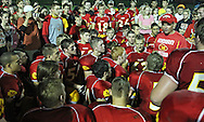 Marion head coach Tony Perkins talks to his team after their win in the first round playoff game at Thomas Park Field in Marion on Wednesday, October 24, 2012.