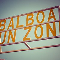 Balboa Fun Zone sign Newport Beach vintage photo. Balboa Fun Zone is a historic amusement park along Newport Harbor on Balboa Peninsula, Newport Beach, California. Picture has nostalgic 1950s style tone and was taken in 2013.
