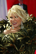 Sept. 4, 2014 - Joan Rivers, the queen of comedy, has died in New York. She was 81. Rivers was undergoing surgery on her vocal cords at a clinic in New York City on Aug. 28 when she stopped breathing and had to be transported to Mount Sinai Hospital. Rivers entered show biz as a stand-up comic. She first gained fame with her appearances on ''The Tonight Show'' with Johnny Carson. Rivers recently transformed herself into a comedian fashion critic of the red carpet with the popular E! Network show, 'Fashion Police.' <br /> <br /> PICTURED: Sept. 21, 200 - Hollywood, California, U.S. -TV Personality JOAN RIVERS arriving at the 55th Annual Primetime Emmy Awards held at the Shrine Auditorium.<br /> ©Exclusivepix