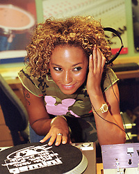 Mel B, Scary spice Poses for photographers at the DJ decks during the official opening of the  Host Media Centre in Chapeltown Leeds on Thursday evening