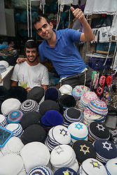 Two sellers of traditional Jewish kippahs (also called a kappel or skull cap) on a market stall in Machane Yehuda market in Jewish west Jerusalem. From a series of travel photos taken in Jerusalem and nearby areas. Photo date: Monday, July 30, 2018. Photo credit should read: Richard Gray/EMPICS
