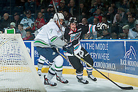 KELOWNA, CANADA - NOVEMBER 25: Sahvan Khaira #7 of Seattle Thunderbirds checks Tanner Wishnowski #9 of Kelowna Rockets behind the net during first period on November 25, 2015 at Prospera Place in Kelowna, British Columbia, Canada.  (Photo by Marissa Baecker/Getty Images)  *** Local Caption *** Sahvan Khaira; Tanner Wishnowski;