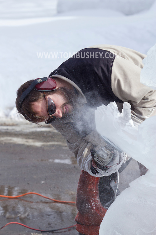 """Wurtsboro, New York - Ice carver Jake Polick works on his sculpture during a contest at the Winterfest on Feb. 8, 2014. Polick's sculpture """"Hopefull Mermaid"""" won third place. The festival is sponsored and organized by the Wurtsboro Board of Trade."""
