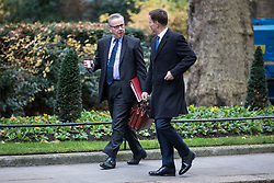 © Licensed to London News Pictures. 05/12/2017. London, UK. Secretary of State for Environment, Food and Rural Affairs Michael Gove (L) and Health Secretary Jeremy Hunt (R) arrive on Downing Street for the weekly Cabinet meeting. Photo credit: Rob Pinney/LNP