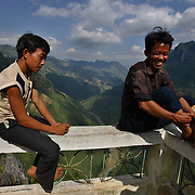 Two boys relax at an observation post along a mountain road in Ha Giang, Vietnam's northernmost province, 22 June, 2007. As cities like Hanoi and Ho Chi Minh roar with Vietnam's economic boom, Ha Giang remains a quiet, serene and beautiful mountain backwater along the Chinese border.