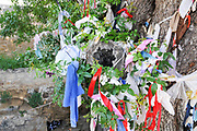 Personal offerings on the tree at Agia Solomoni Catacomb, Paphos, Cyprus