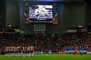 The Rangers and Feyenoord teams observe a minutes silence in memory of Fernando Ricksen, a former Rangers and Netherlands player, who passed away the previous day, after suffering from Motor Neurone Disease, before the Europa League match between Rangers FC and Feyenoord Rotterdam at Ibrox Stadium, Glasgow, Scotland on 19 September 2019.