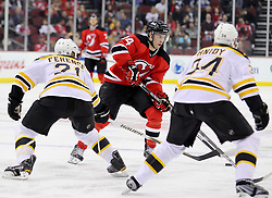 Apr 10; Newark, NJ, USA; New Jersey Devils center Adam Henrique (14) skates with the puck during the second period of their game at the Prudential Center.