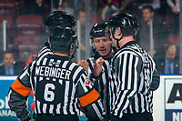 KELOWNA, BC - NOVEMBER 16: Referees Fraser Lawrence and Kevin Webinger, and linesmen Dustin Minty and Cody Wanner stand at center ice at the Kelowna Rockets against the Kamloops Blazers at Prospera Place on November 16, 2019 in Kelowna, Canada. (Photo by Marissa Baecker/Shoot the Breeze)