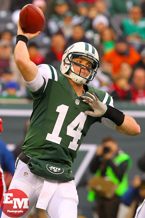 Dec 2, 2012; East Rutherford, NJ, USA; New York Jets quarterback Greg McElroy (14) throws a pass the ball during the second half of their game against the Arizona Cardinals at MetLIfe Stadium. The Jets defeated the Cardinals 7-6.