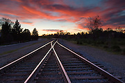 Idaho. Boise. Dramatic red clouds sunset over train tracks near the Train Depot.