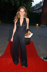 ANDREA DELLAL at a party to celebrate the opening of Roger Vivier in London held at The Orangery, Kensington Palace, London on 10th May 2006.<br />