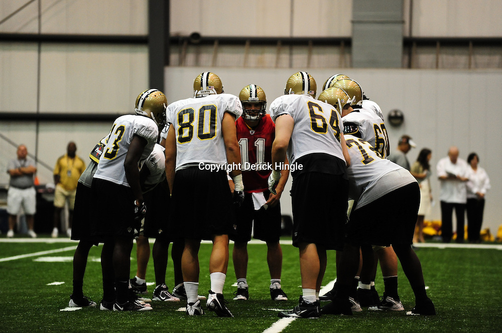 July 30, 2010; Metairie, LA, USA; New Orleans Saints quarterback Patrick Ramsey (11) calls a play from the huddle during a training camp practice at the New Orleans Saints indoor practice facility. Mandatory Credit: Derick E. Hingle