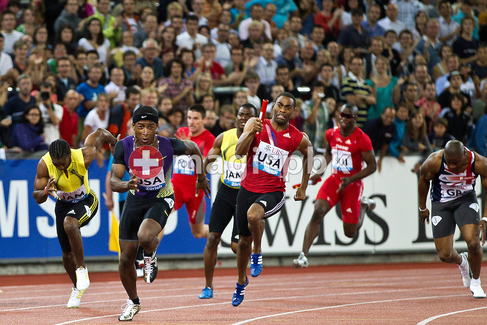 Michael Rodgers of the USA (2nd L) receives the baton from compatriot Tyson Gay (C) during the men's 4x100m relay in the men's 4x100m Relay at the IAAF Diamond League meeting at the Letzigrund Stadium in Zurich, Switzerland, Thursday, Aug. 19, 2010. (Photo by Patrick B. Kraemer / MAGICPBK)