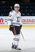 KELOWNA, CANADA - NOVEMBER 6: Dominik Volek #12 of the Red Deer Rebels warms up on the ice against the Kelowna Rockets on NOVEMBER 6, 2013 at Prospera Place in Kelowna, British Columbia, Canada.   (Photo by Marissa Baecker/Shoot the Breeze)  ***  Local Caption  ***