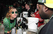 Lisa Jennings, from Dayton gets a drink order from John Bailey, from Dayton at the Dublin Pub, Saturday night, March 17th.