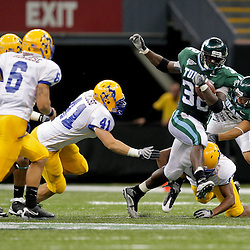 Sep 26, 2009; New Orleans, LA, USA; Tulane Green Wave running back Andre Anderson (32) runs against the McNesse State Cowboys defense at the Louisiana Superdome. Tulane defeated McNeese State 42-32. Mandatory Credit: Derick E. Hingle-US PRESSWIRE