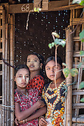 Sisters on the doorstep of their bamboo shelter at the Ohn Daw Gyi Camp near Sittwe. 2015-02-05.