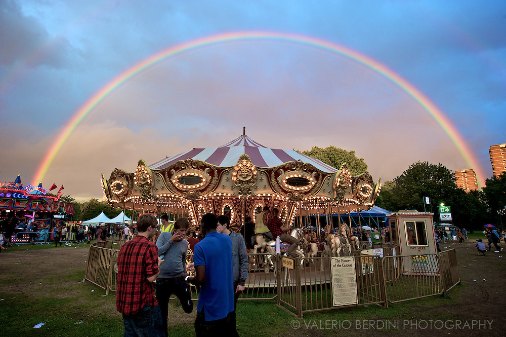 Rainbow  after a summer shower embraces the carousel at Field Day Festival @ Victoria park. (East) London. UK