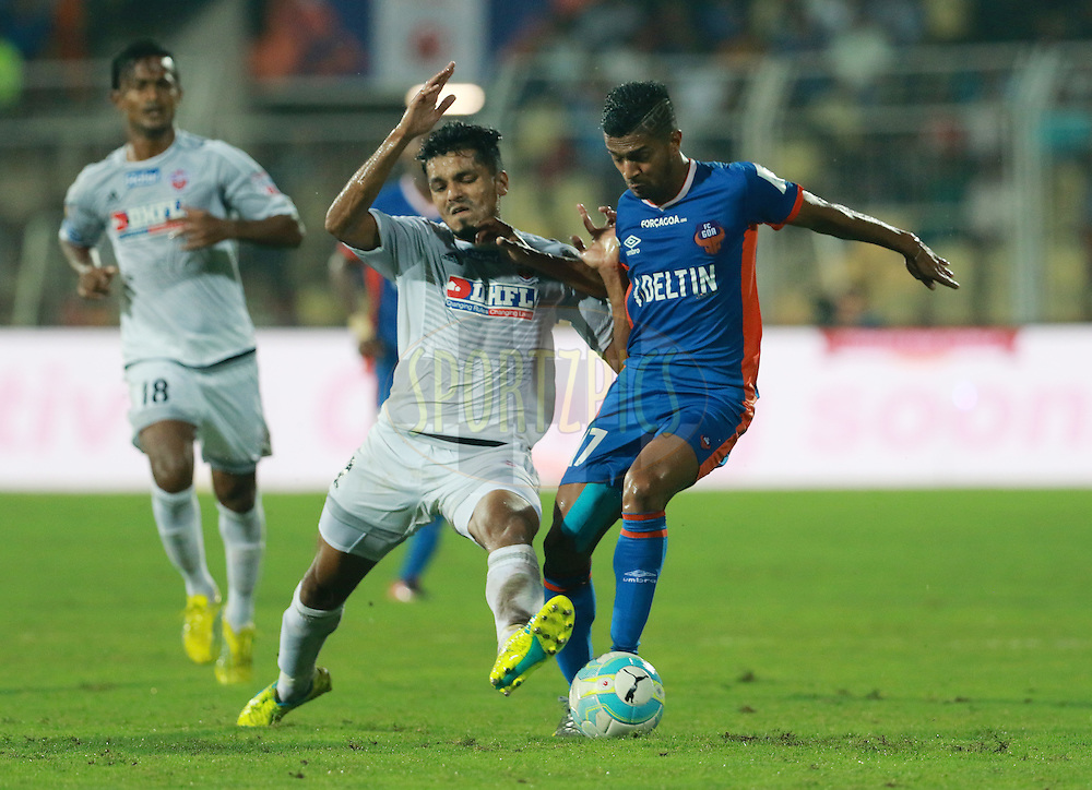 Rahul Bheke of FC Pune City and Mandarrao Dattarao Dessai of FC Goa in action during match 8 of the Indian Super League (ISL) season 3 between FC Goa and FC Pune City held at the Fatorda Stadium in Goa, India on the 8th October 2016.<br /> <br /> Photo by Vipin Pawar / ISL/ SPORTZPICS
