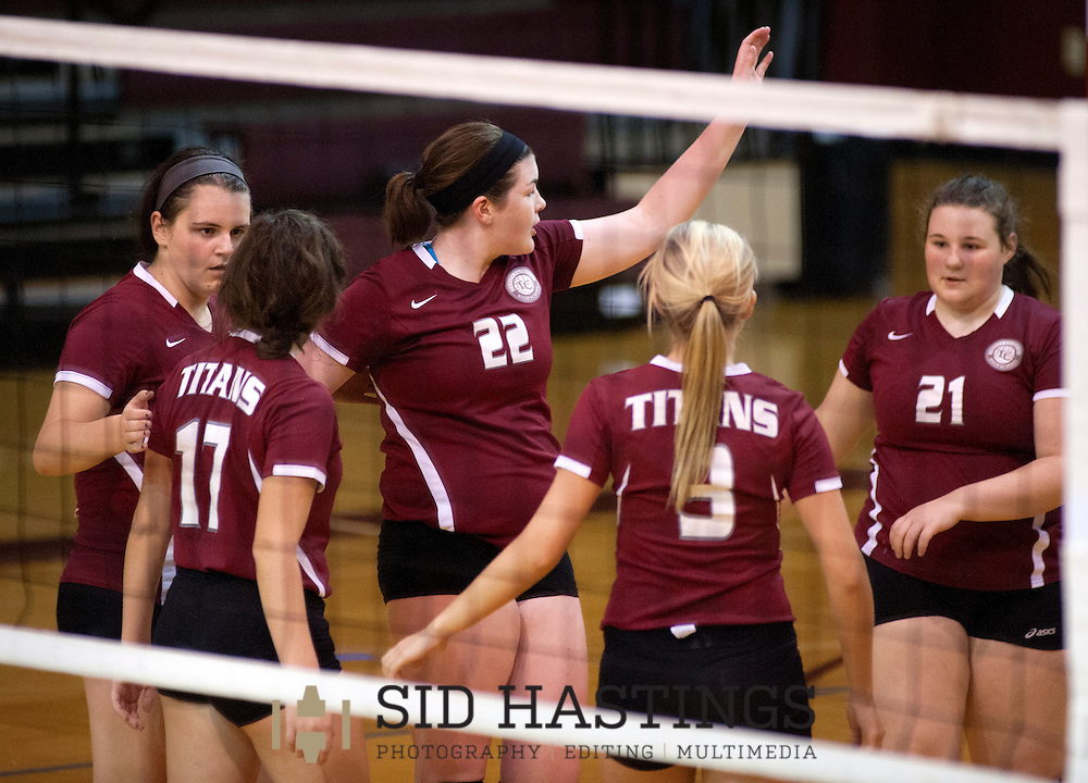 29 SEPT. 2015 -- ST. LOUIS -- Trinity Catholic High School volleyball players Jess Eaton (16), Holly Hennessey (17), Abby Grumich (22), Melissa Peters (3) and Kyra Walsh (21) celebrate during the Titans' match with Cardinal Ritter College Prep at Cardinal Ritter in St. Louis Tuesday, Sept. 29, 2015.  The Titans won, 2-0, raising their record to 13-7 on the season. Photo © copyright 2015 Sid Hastings.