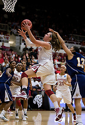 March 20, 2010; Stanford, CA, USA; Stanford Cardinal forward Kayla Pedersen (14) shoots past UC Riverside Highlanders forward Marissa Rivera (13) during the second half in the first round of the 2010 NCAA womens basketball tournament at Maples Pavilion.  Stanford defeated UC Riverside 79-47.