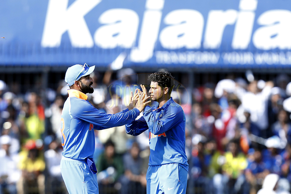 Kuldeep Yadav of India celebrates the wicket of  Aaron Finch of Australia with Virat Kohli captain of India during the 3rd One Day International between India and Australia held at the Holkar Stadium in Indore on the 24th  September 2017<br /> <br /> Photo by Arjun Singh / BCCI / SPORTZPICS