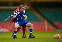 CARDIFF, WALES - Saturday, October 11, 2008: Wales' Chris Gunter and Liechtenstein's Beni Fischer during the 2010 FIFA World Cup South Africa Qualifying Group 4 match at the Millennium Stadium. (Photo by David Rawcliffe/Propaganda)