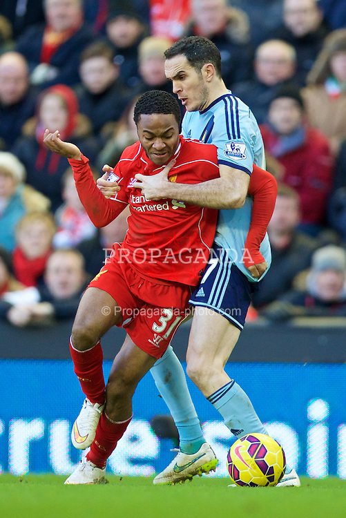 LIVERPOOL, ENGLAND - Saturday, January 31, 2015: Liverpool's Raheem Sterling in action against West Ham United's Stewart Downing during the Premier League match at Anfield. (Pic by David Rawcliffe/Propaganda)