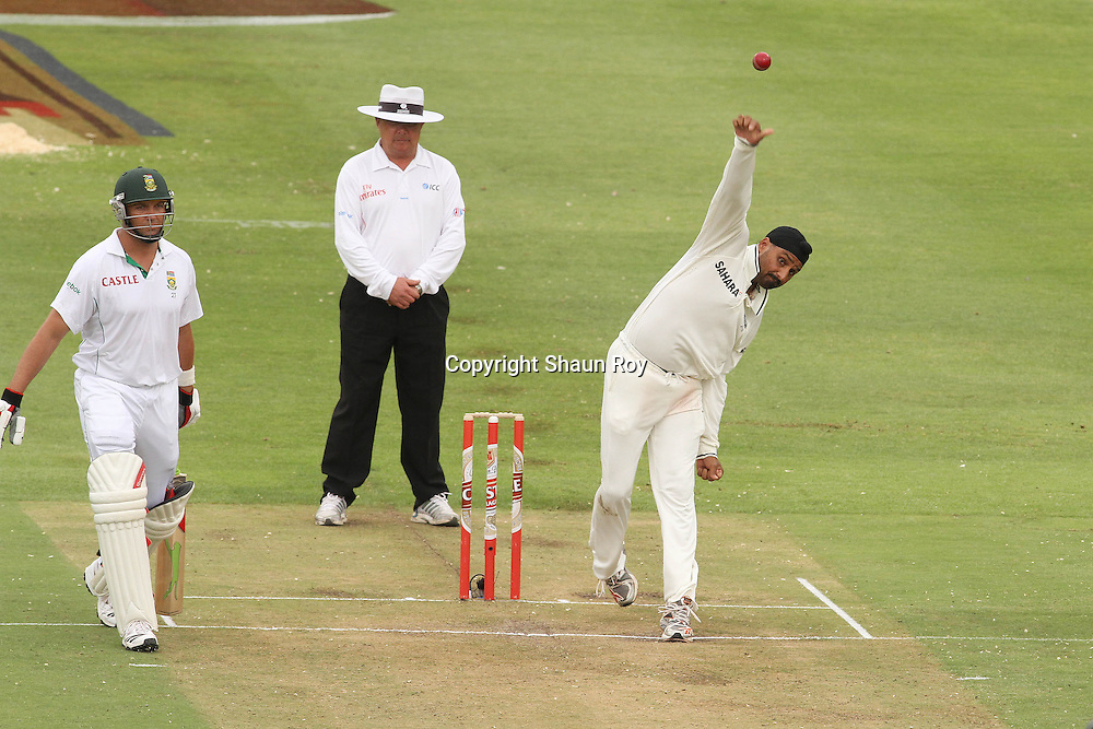 CAPE TOWN, SOUTH AFRICA - 2 January 2011, Harbhajan Singh of India sends down a delivery as Jacques Kallis of South Africa backs up during day 1 of the 3rd Castle Test between South Africa and India held at Sahara Park Newlands Stadium in Cape Town, South Africa on the 2 January 2011 .Photo by: Shaun Roy