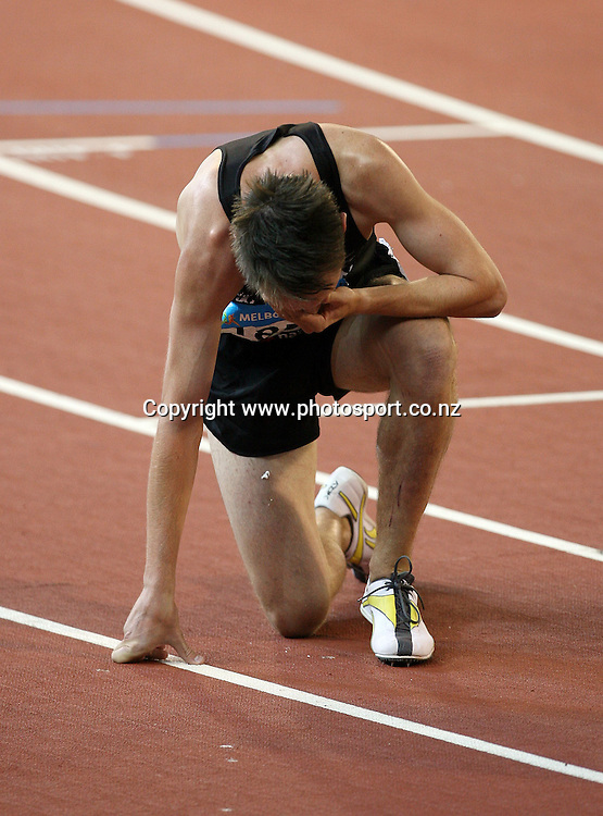 Nick Willis (NZL) breaks down after winning the Men's 1500m final on Day 10 of the XVIII Commonwealth Games at the MCG, Melbourne, Australia on Saturday 25 March, 2006. Photo: Hannah Johnston/PHOTOSPORT