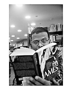 Journalist and author Jerry Pinto photographed at the Oxford Book Store, Mumbai, India. By Siddharth Siva..scan from grainy 35mm b/w negative