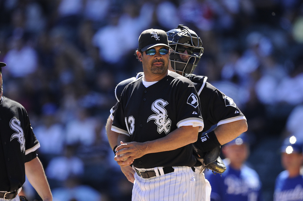 CHICAGO - SEPTEMBER 12:  Manager Ozzie Guillen #13 of the Chicago White Sox looks on while making a pitching change against the Kansas City Royals on September 12, 2010 at U.S. Cellular Field in Chicago, Illinois.  The White Sox defeated the Royals 12-6.  (Photo by Ron Vesely)