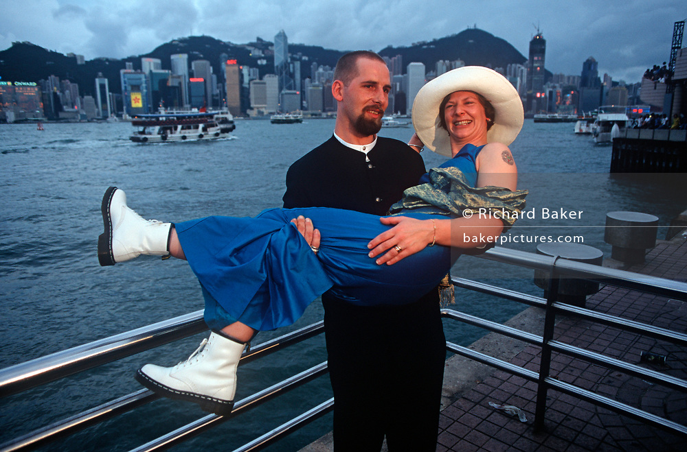 While still a British colony, a Western couple stand with a backdrop of Hong Kong Harbour waters, on 21st April 1995, in Kowloon, Hong Kong, China. (Photo by Richard Baker / In Pictures via Getty Images)