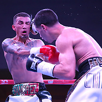 "Jean Carlos ""Chapito"" Rivera (R) and  Jason Sanchez exchange blows during their championship boxing match for the WBO Junior World Title at the Hotel El Panama Convention Center on Wednesday, October 31, 2018 in Panama City, Panama. (Alex Menendez via AP)"