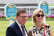 A couple pose for a picture outside the Parade Ring entrance prior to the third day of the Dante Festival at York Racecourse, York, United Kingdom on 17 May 2019.