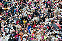 © licensed to London News Pictures.16/06/2011. Ascot, UK.  Corwds watch HRH the Queen arrive Ladies day at Royal Ascot races today (16/06/2011). The 5 day showcase event is one of the highlights of the racing calendar. Horse racing has been held at the famous Berkshire course since 1711 and tradition is a hallmark of the meeting. Top hats and tails remain compulsory in parts of the course. Photo credit should read: Ben Cawthra/LNP